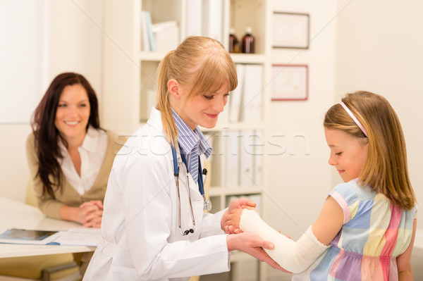 Pediatrician checking bandage girl arm Stock photo © CandyboxPhoto