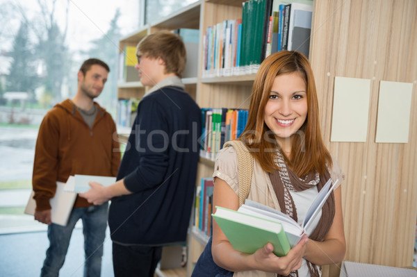 College student holding books in library Stock photo © CandyboxPhoto