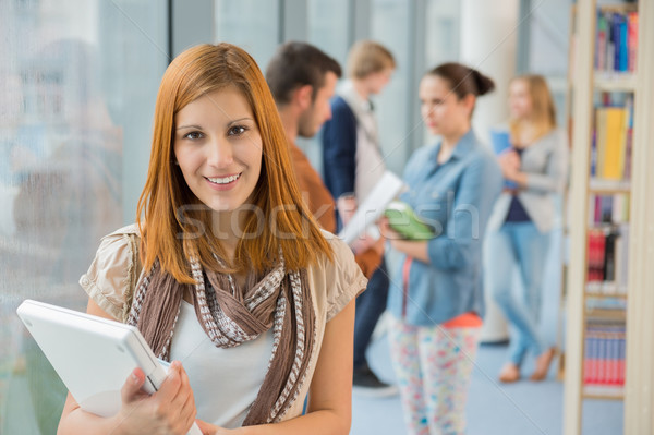 Girl holding laptop in college library Stock photo © CandyboxPhoto