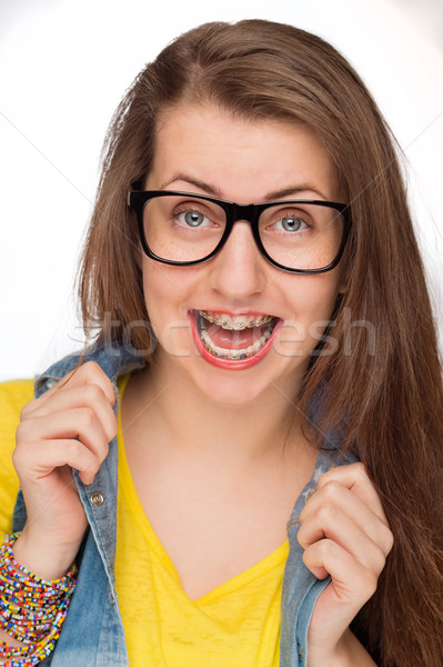 Crazy girl with braces wearing geek glasses Stock photo © CandyboxPhoto