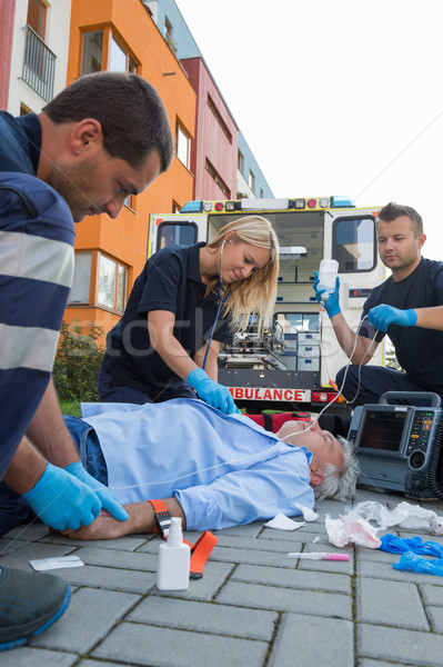 Emergency team helping injured elderly patient Stock photo © CandyboxPhoto