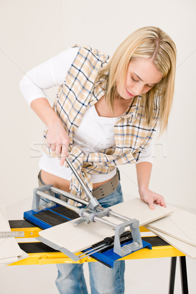 Home improvement - handywoman cutting tile Stock photo © CandyboxPhoto