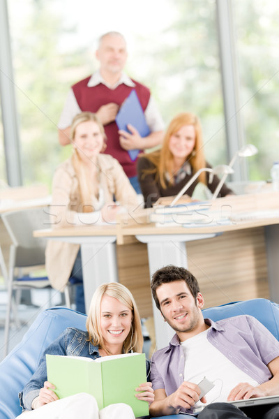 High-school students with mature professor listen music Stock photo © CandyboxPhoto