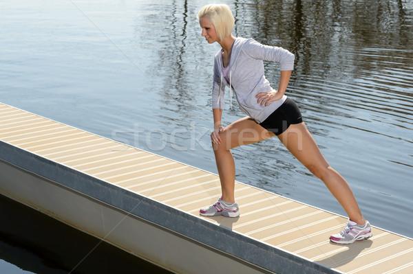 Sport woman stretch body on lake pier Stock photo © CandyboxPhoto