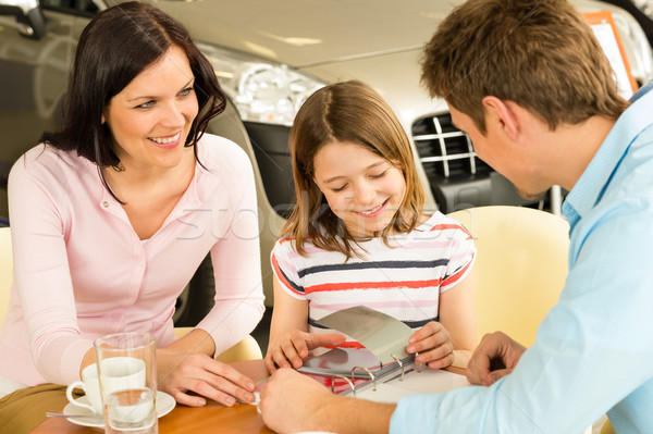 Family looking at color swatches car showroom Stock photo © CandyboxPhoto