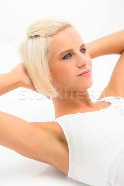 Fitness woman exercise abs sit-ups on white Stock photo © CandyboxPhoto