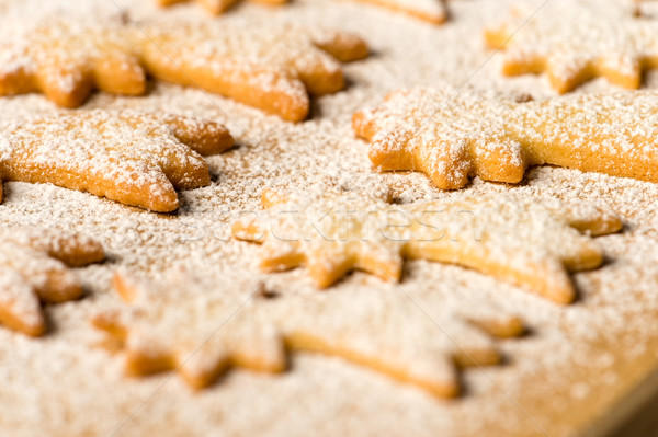 Stock photo: Baking christmas cookies comet star powdered sugar