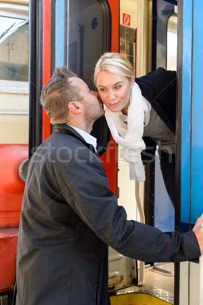 Man kissing woman goodbye on cheek train Stock photo © CandyboxPhoto