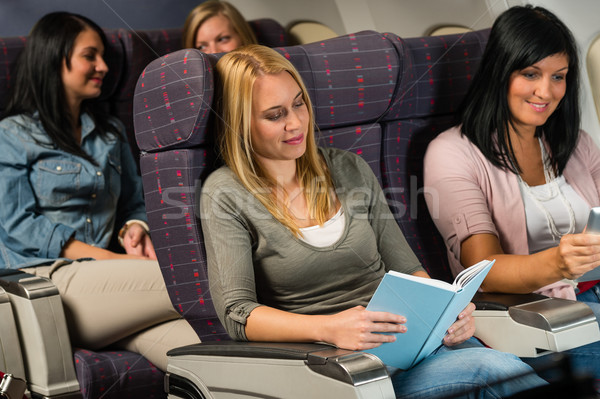 Young woman passenger read book airplane flight Stock photo © CandyboxPhoto