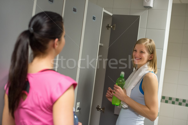 Woman talking with friend in changing room Stock photo © CandyboxPhoto