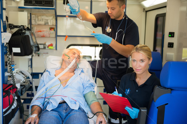 Paramedic treating injured patient in ambulance Stock photo © CandyboxPhoto