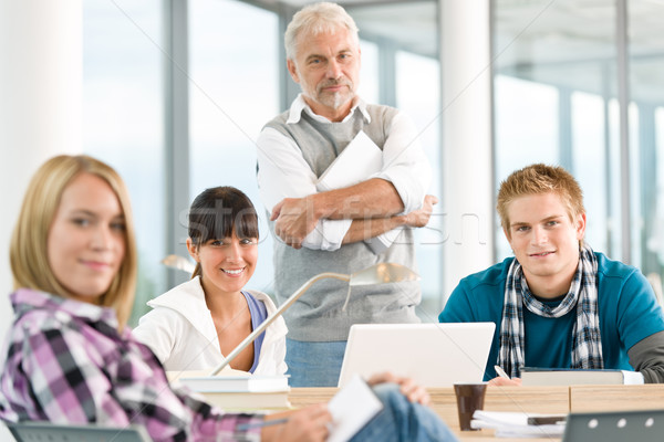 High school - three students with mature professor Stock photo © CandyboxPhoto
