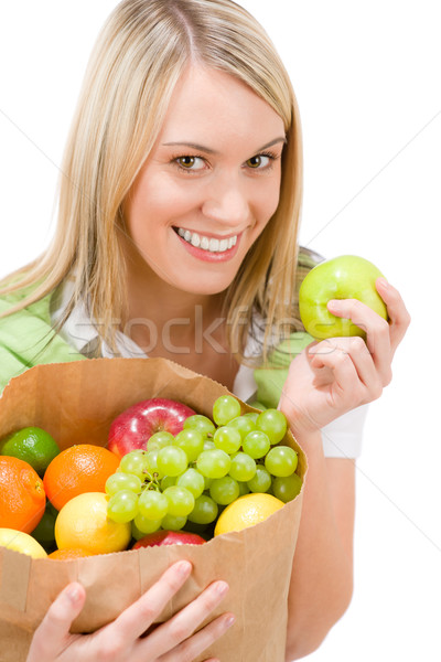 Healthy lifestyle - woman with fruit shopping paper bag Stock photo © CandyboxPhoto