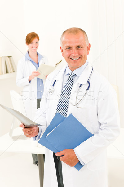 Medical doctor team smiling male hold x-ray Stock photo © CandyboxPhoto