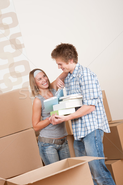 Moving house: Young couple with box in new home Stock photo © CandyboxPhoto