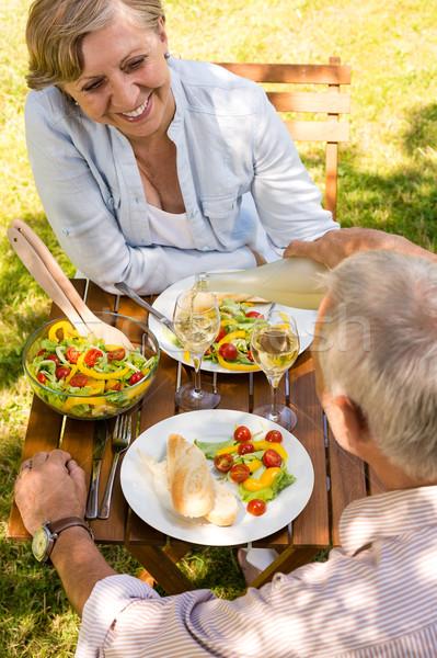 Gepensioneerd paar eten drinken buitenshuis glimlachend Stockfoto © CandyboxPhoto