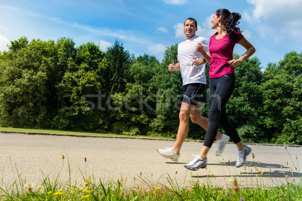 Portrait of fit couple running outdoors Stock photo © CandyboxPhoto