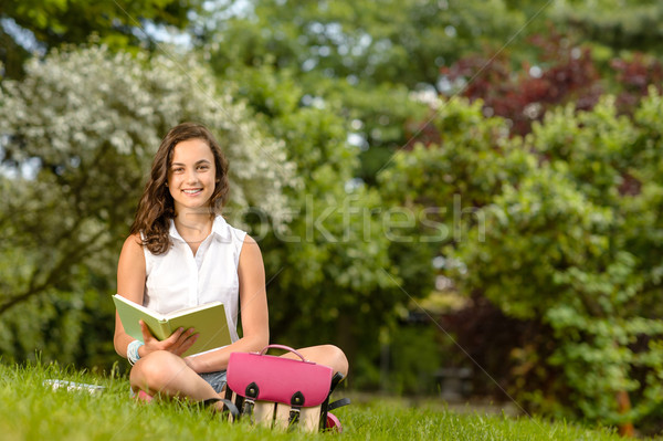 Student girl sitting grass with open book Stock photo © CandyboxPhoto