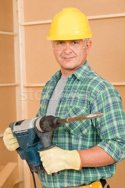 Tuttofare lavoro maturo casa interni Foto d'archivio © CandyboxPhoto