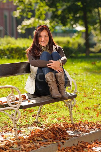 Autumn sunset park woman sitting on bench Stock photo © CandyboxPhoto