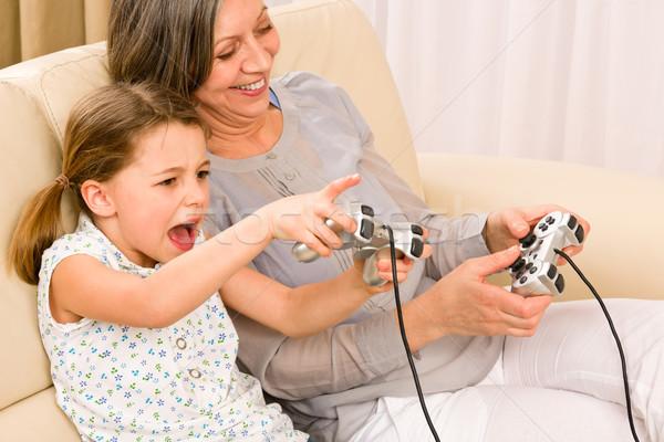 Büyükanne torun oynamak bilgisayar oyunu hevesli genç kız Stok fotoğraf © CandyboxPhoto