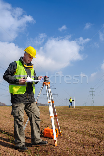 Geodesist measure land look construction plan Stock photo © CandyboxPhoto