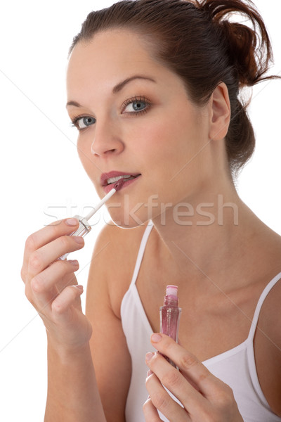 Body care series - Young beautiful woman applying lipstick Stock photo © CandyboxPhoto