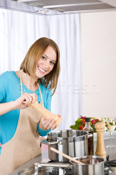 Cooking - Happy woman by stove in kitchen Stock photo © CandyboxPhoto
