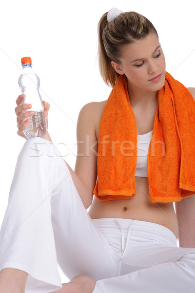 Stock photo: Fitness - Young sportive woman with water and towel
