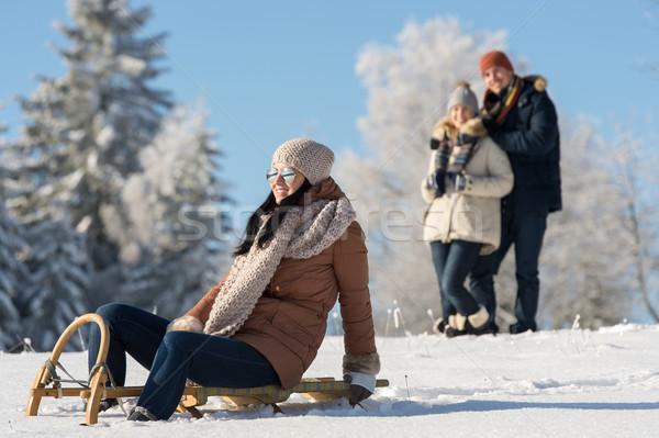 Friends enjoy sunny winter day on sledge Stock photo © CandyboxPhoto
