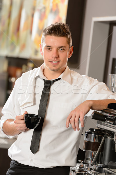 Attractive waiter leaning on espresso machine Stock photo © CandyboxPhoto