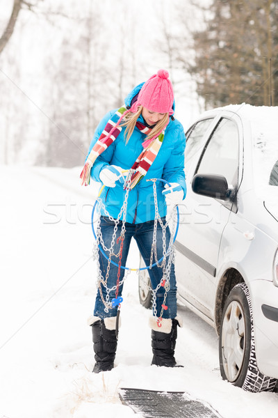 Woman having problems with car snow chains Stock photo © CandyboxPhoto