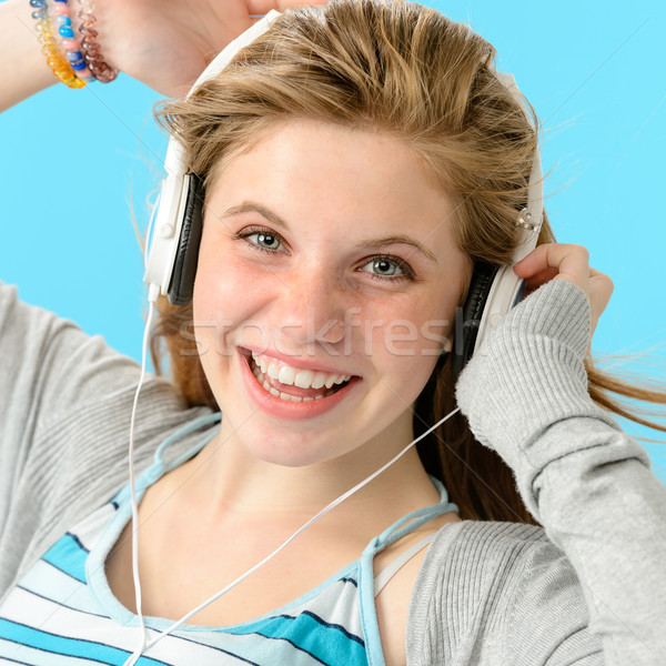 Carefree teenage girl dancing to music Stock photo © CandyboxPhoto