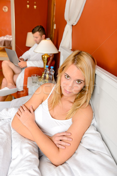 Unhappy woman argument bed husband playing laptop Stock photo © CandyboxPhoto