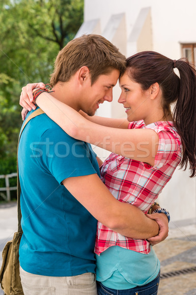 Young happy affectionate couple flirting outdoors Stock photo © CandyboxPhoto
