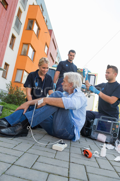 Emergency team helping injured patient on street Stock photo © CandyboxPhoto