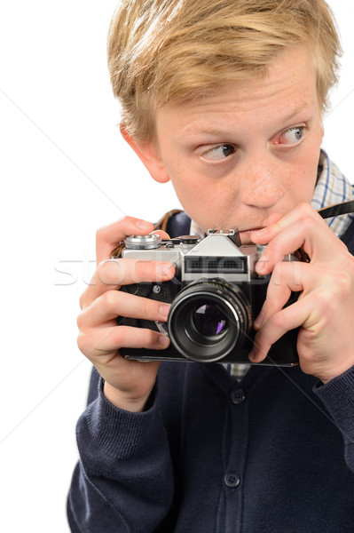 Suspicious teenage boy holding retro camera Stock photo © CandyboxPhoto