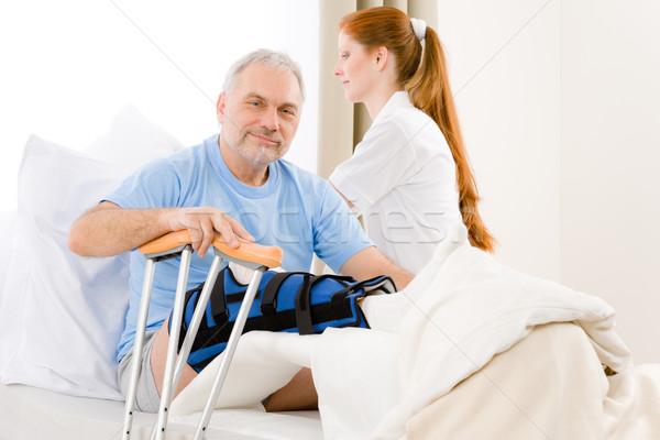 больницу женщины медсестры ухода пациент сломанной ногой Сток-фото © CandyboxPhoto