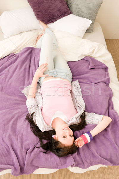 Fiatal boldog diák pihen ágy lakás Stock fotó © CandyboxPhoto