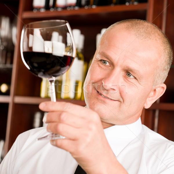 Cameriere guardando vetro ristorante bar Foto d'archivio © CandyboxPhoto