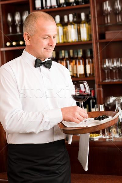 Wine bar waiter mature serve glass restaurant Stock photo © CandyboxPhoto