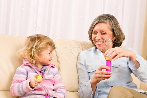 Kislány nagymama játék buborék fúvó kicsi Stock fotó © CandyboxPhoto