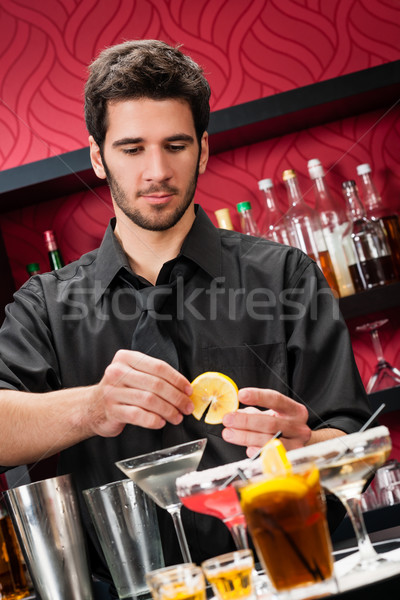 Young bartender make cocktail prepare drinks Stock photo © CandyboxPhoto