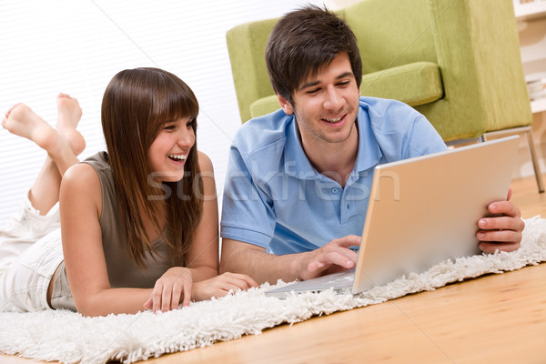 Student - two teenager with laptop in living room Stock photo © CandyboxPhoto