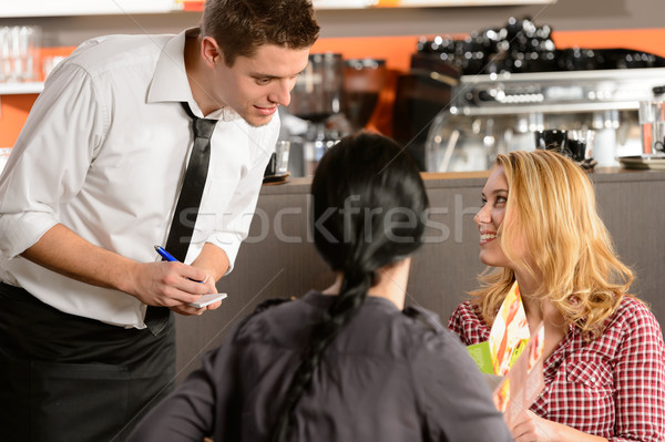 Waiter taking orders from young woman customer Stock photo © CandyboxPhoto
