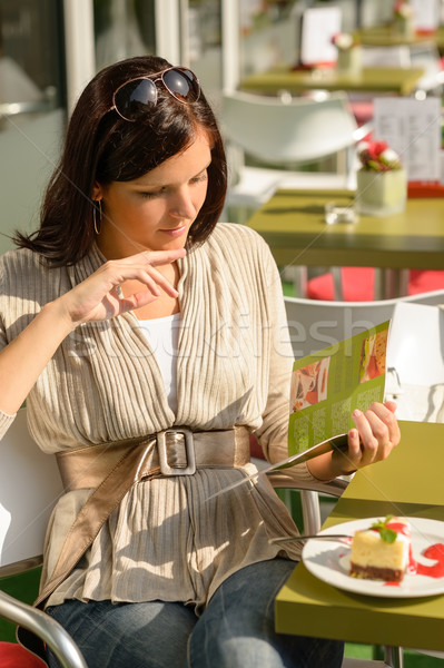 Woman at cafe terrace choosing from menu Stock photo © CandyboxPhoto