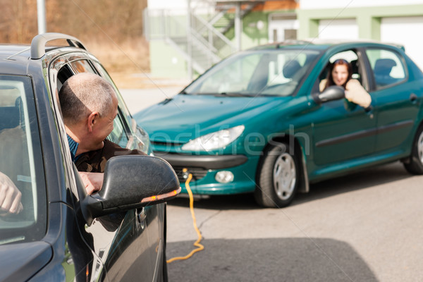 Man helping woman by pulling her car Stock photo © CandyboxPhoto