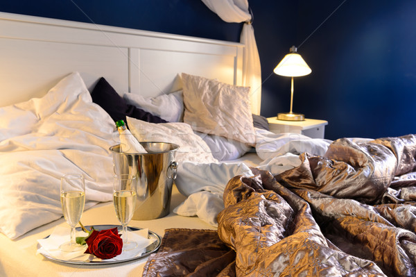 Romantic bedroom rumpled covers hotel champagne bucket Stock photo © CandyboxPhoto