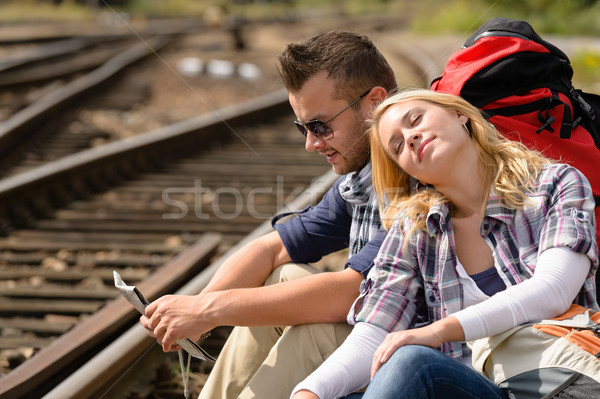 Couple backpack traveling resting on railroad map Stock photo © CandyboxPhoto
