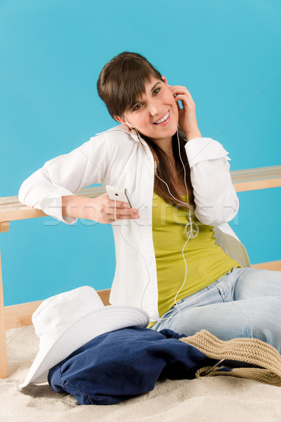 Summer - young woman listen music mp3 player Stock photo © CandyboxPhoto